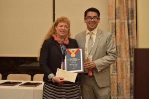 Judy Smrha accepting the award on Alexia's behalf at the Phi Beta Delta Honor Society conference two weeks ago in California.